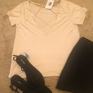 Tops - NWT Boutique pale pink criss cross back top